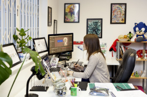 Anime portrait artist, Mair Perkins, at work in her studio.