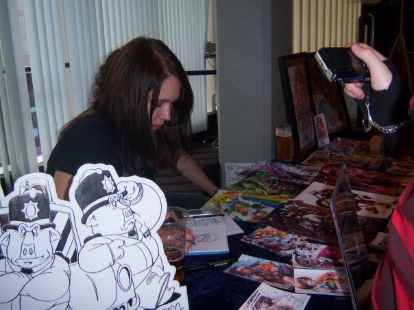 Mair drawing anime portraits at J Culture con 2009